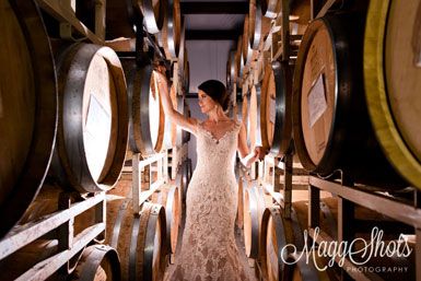 picture of bride with wine barrels on racks